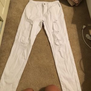 Worn once WHITE RIPPED JEANS